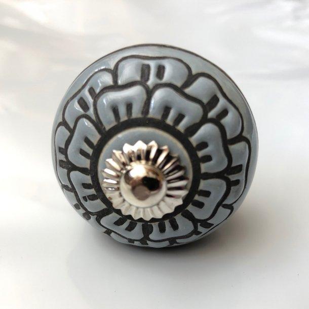 Gråblå knop med håndlavet sort mønster