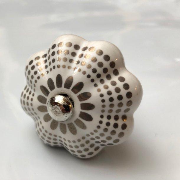 Lækkert porcelænsgreb med flot sølvmønster