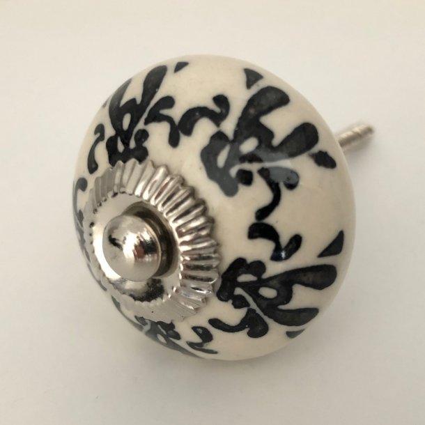 Greb i porcelæn med sort mønster