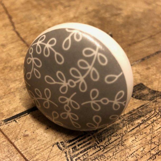 Greb i porcelæn med bladmønster - grå